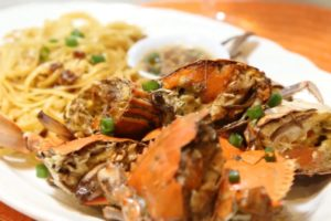 CRUSTACEAN-INSPIRED GARLIC NOODLES AND ROASTED CRAB CRUSTACEAN GARLIC NOODLES